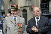 French Defence Minister JeanYves Le Drian and French chief commander of the Foreign Legion Christophe de Saint Chamas pose as they arrive on August 4...