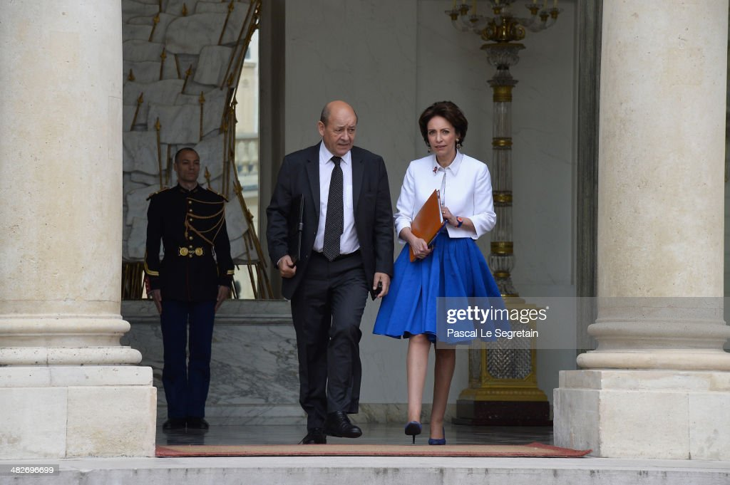 French Defence Minister <a gi-track='captionPersonalityLinkClicked' href=/galleries/search?phrase=Jean-Yves+Le+Drian&family=editorial&specificpeople=2122785 ng-click='$event.stopPropagation()'>Jean-Yves Le Drian</a> and French Social Affairs Minister Marisol Touraine (R) leave the Elysee Palace after the first cabinet meeting of French new government on April 4, 2014 in Paris, France.