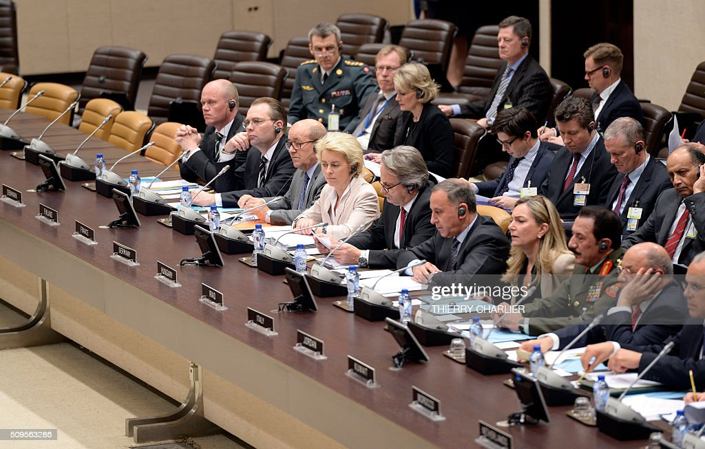 French Defence Minister Jean-Yves Le Drian (3L) and German Defence Minister Ursula von der Leyen (4L) attend a Global Coalition meeting held at the NATO headquarters in Brussels, February 11, 2016. NATO launched an unprecedented naval mission in the Aegean Sea to tackle people smugglers taking migrants and refugees from the Turkish coast, Secretary General Jens Stoltenberg said on Thursday. / AFP / THIERRY CHARLIER