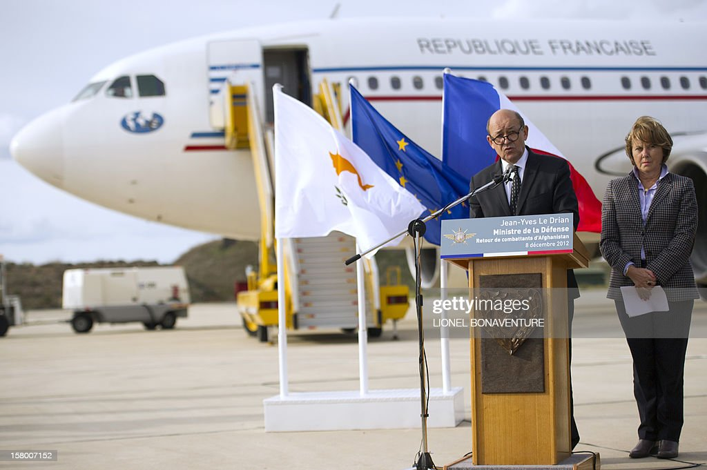 French Defence Minister, Jean-Yves Le Drian (C), and national assembly's defense commission President Patricia Adam (R) address French soldiers Paphos airport in Cyprus in December 8, 2012 before leaving for France. Le Drian today welcomed some 150 French soldiers returning from Afghanistan.