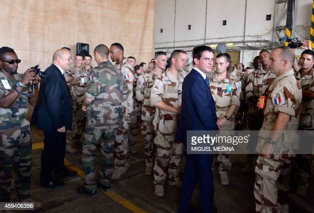 French Defence minister JeanYves Le Drian and Prime Minister Manuel Valls speak with French troops at the Kossei military base in N'Djamena on...