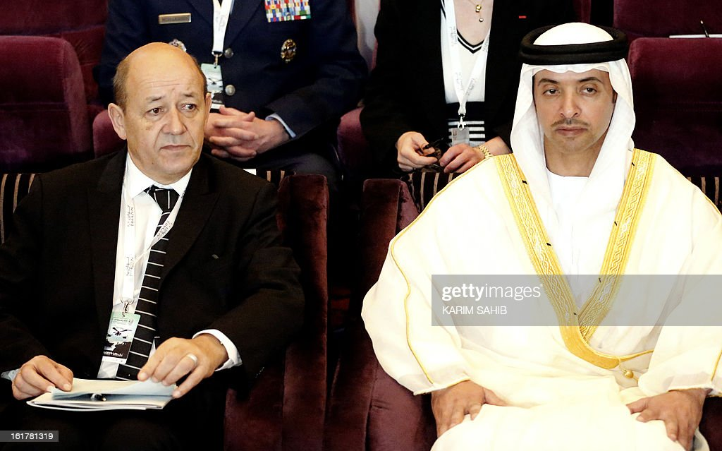 French Defence Minister Jean-Yves Le Drian (L) and Sheikh Hazza bin Zayed Al Nahyan, the UAE national security advisor, attend the opening of the INEGMA (Institute for Near East and Gulf Military Analysis) defence conference on February 16, 2013, in Abu Dhabi.