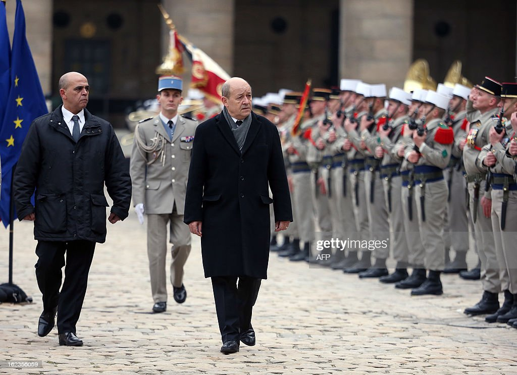 French Defence minister Jean-Yves Le Drian (R) and Veterans junior minister Kader Arif (L) review a guard of honour during a national tribute ceremony to late French Staff Sergeant Harold Vormezeele, held in the Hotel des Invalides courtyard on February 22, 2013 in Paris. Vormezeele, a NCO and commando with the 2nd Foreign Parachute Regiment, an elite unit of the French Foreign Legion, was killed on February 19 during an operation in northern Mali against Islamist rebels. He was the second French soldier killed since the start of France's military intervention in Mali on January 11.