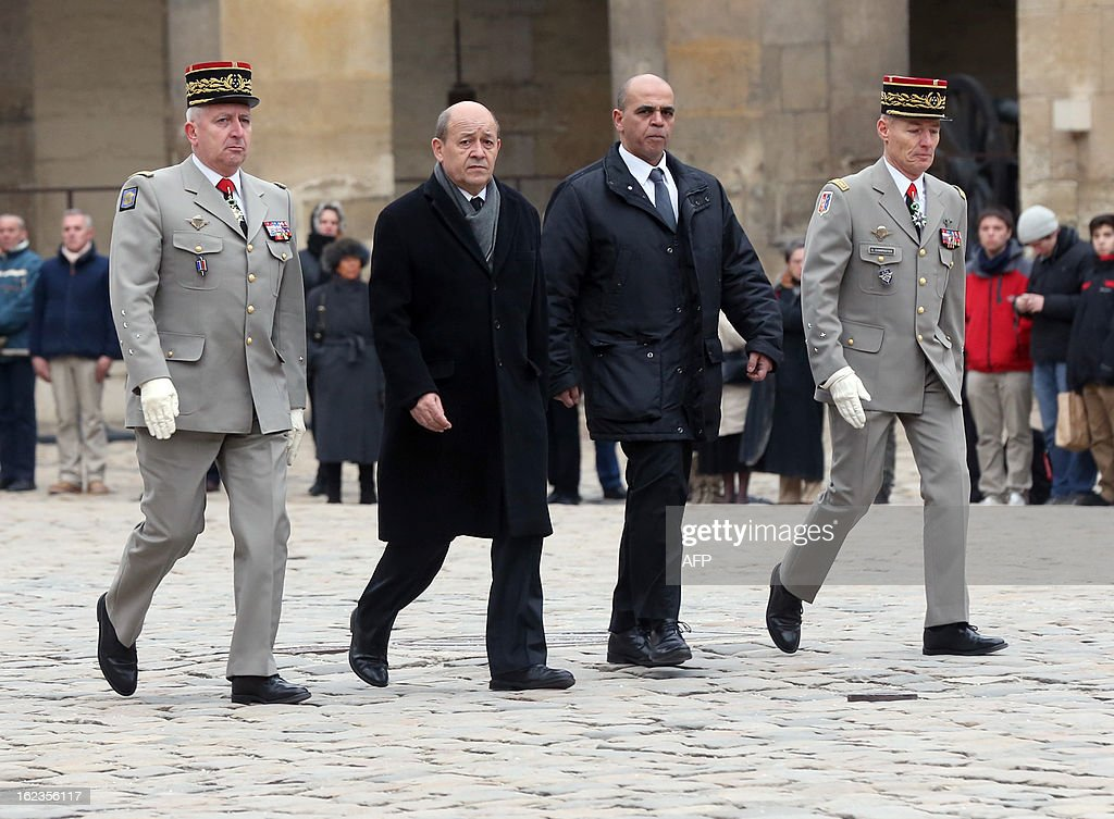 French Defence minister Jean-Yves Le Drian (2nd L) and Veterans junior minister Kader Arif (2nd R), French army chief of staff General Bertrand Ract-Madoux (L) and Paris military governor Herve Charpentier (R) review a guard of honour during a national tribute ceremony to late French Staff Sergeant Harold Vormezeele, held in the Hotel des Invalides courtyard on February 22, 2013 in Paris. Vormezeele, a NCO and commando with the 2nd Foreign Parachute Regiment, an elite unit of the French Foreign Legion, was killed on February 19 during an operation in northern Mali against Islamist rebels. He was the second French soldier killed since the start of France's military intervention in Mali on January 11.