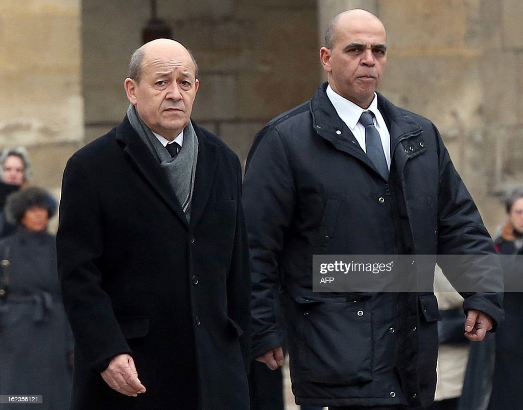 French Defence minister Jean-Yves Le Drian (L) and Veterans junior minister Kader Arif review a guard of honour during a national tribute ceremony to late French Staff Sergeant Harold Vormezeele, held in the Hotel des Invalides courtyard on February 22, 2013 in Paris. Vormezeele, a NCO and commando with the 2nd Foreign Parachute Regiment, an elite unit of the French Foreign Legion, was killed on February 19 during an operation in northern Mali against Islamist rebels. He was the second French soldier killed since the start of France's military intervention in Mali on January 11.