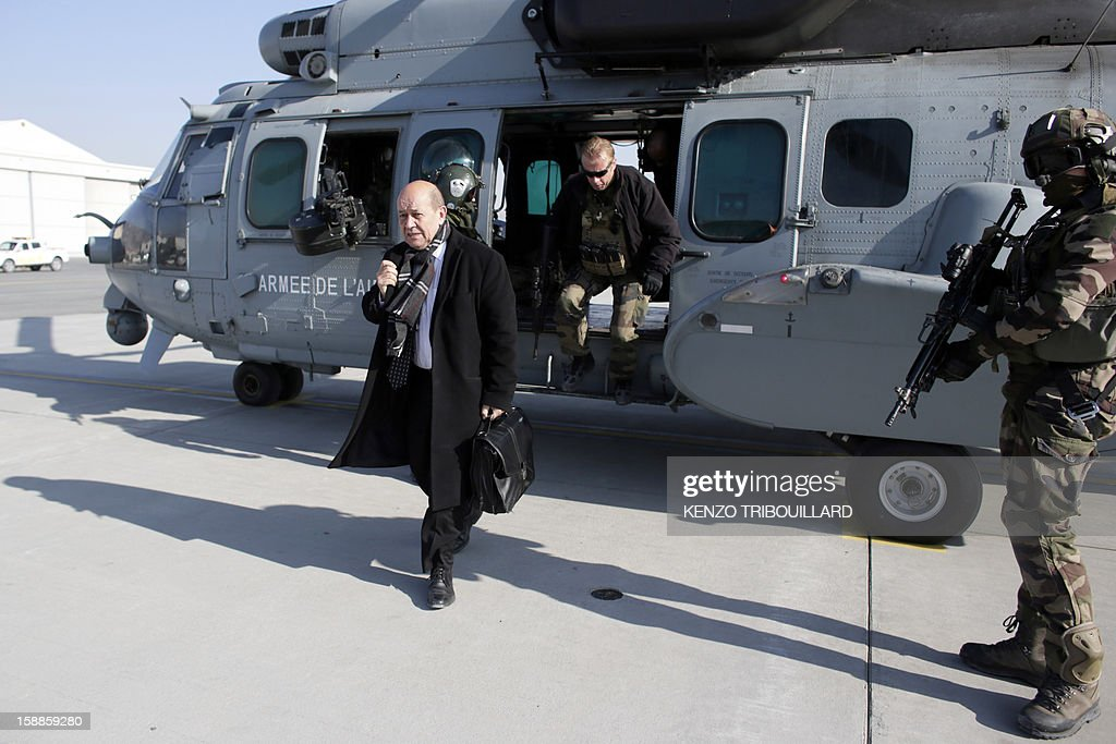 French Defence Minister Jean-Yves Le Drian (L) arrives at the Kabul International Airport (KAIA) on January 01, 2013. AFP PHOTO KENZO TRIBOUILLARD