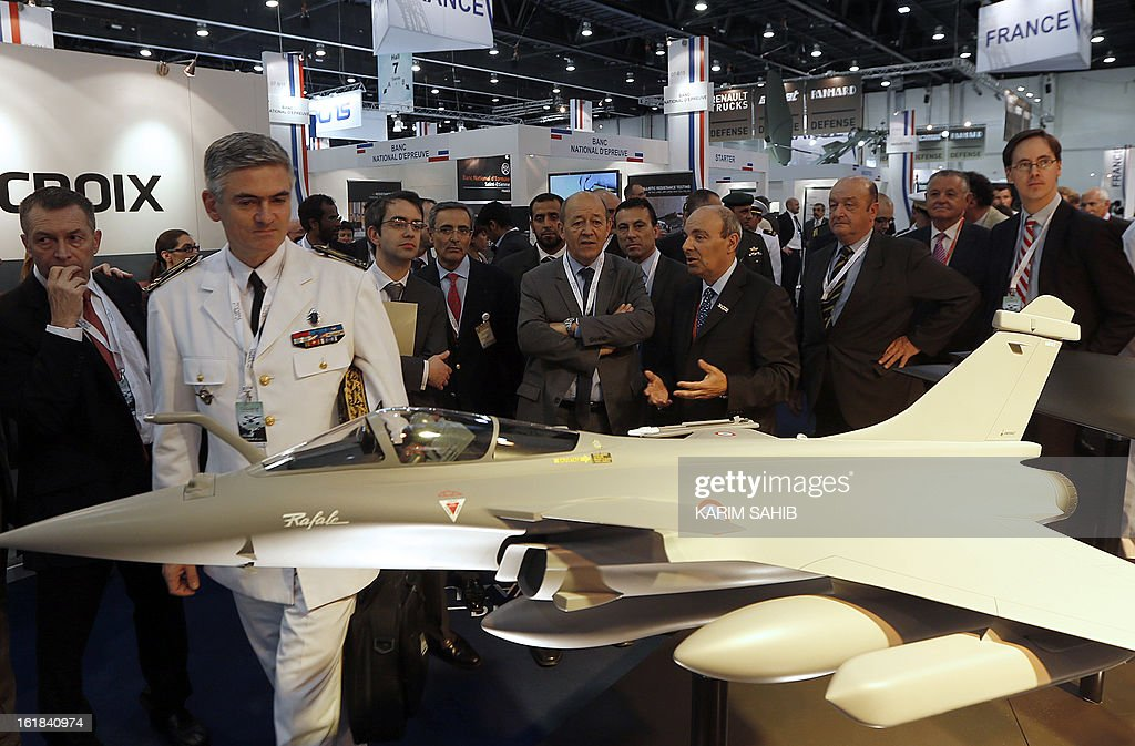 French Defence Minister Jean-Yves Le Drian (C) attends the opening of the International Defence Exhibition and Conference (IDEX) at the Abu Dhabi National Exhibition Centre in the Emirati capital on February 17, 2013. A top French defence industry official said that talks to sell Rafale jet fighters to the UAE were 'progressing well', expressing confidence that a deal could be reached with the Gulf state.