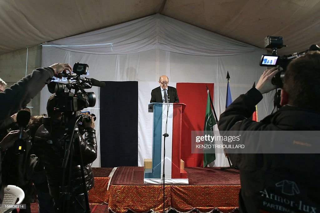 French Defence Minister Jean-Yves Le Drian delivers a speech during the celebrations of the New Year's eve with French soldiers at Warehouse base in Kabul on December 31, 2012. On December 15, France flew its last combat troops out of Afghanistan, two years before allied nations in the 100,000-strong NATO mission led by the United States are due to recall their fighting forces. TRIBOUILLARD