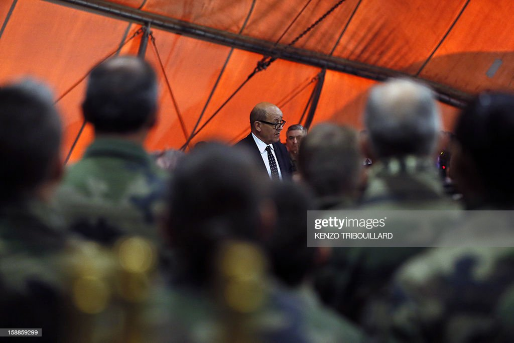 French Defence Minister Jean-Yves Le Drian (C) delivers a speech during his New Year wishes to French soldiers at Kabul International Airport (KAIA) on January 01, 2013.