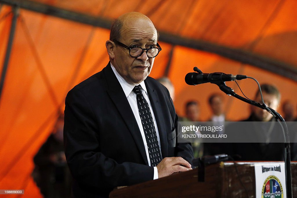 French Defence Minister Jean-Yves Le Drian delivers a speech during his New Year wishes to French soldiers at Kabul International Airport (KAIA) on January 01, 2013.