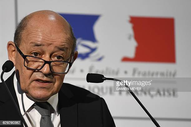 French Defence minister JeanYves Le Drian delivers a speech during his visit at the Direction générale de larmement on december 12 2016 in Bruz near...