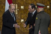 French Defence minister JeanYves Le Drian Egyptian President Abdel Fattah alSisi and his Defence Minister General Sedki Sobhi take part in a signing...