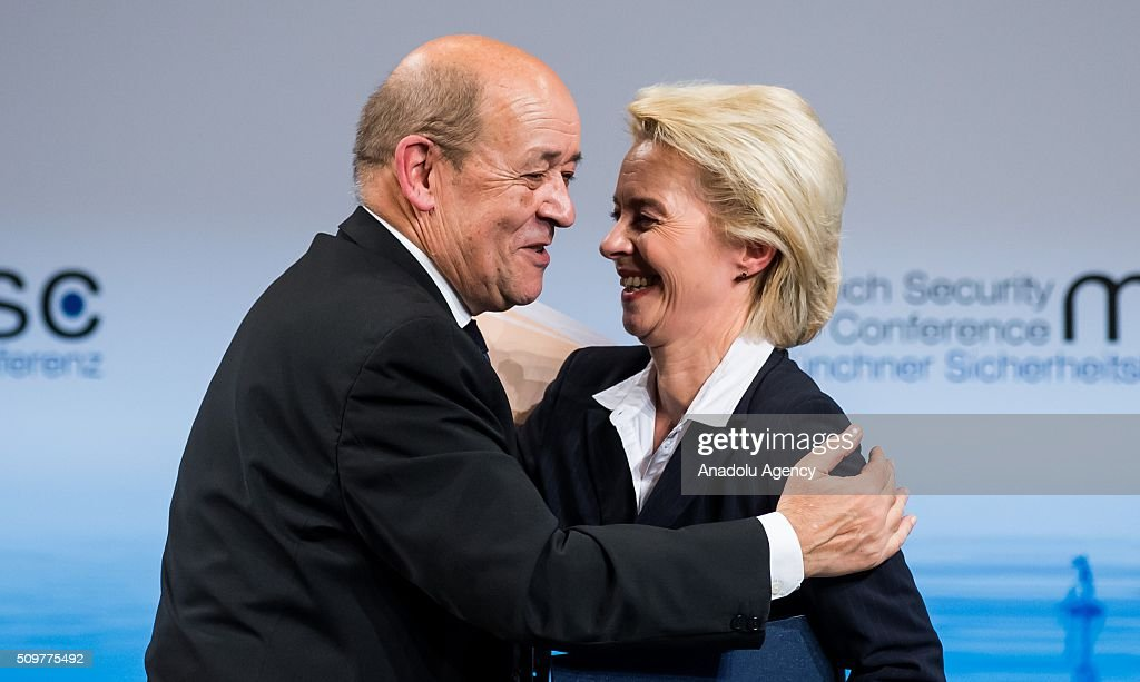 French Defence Minister Jean-Yves Le Drian (L) embraces German Defence Minister Ursula Von Der Leyen (R) during the 52nd Security Conference in Munich, Germany on February 12, 2016. The conference on security policy takes place from Feb. 12, 2016 until Feb. 14, 2016.