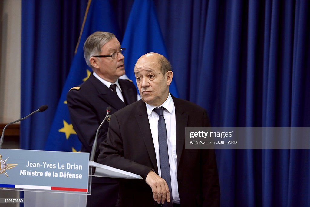 French Defence Minister Jean-Yves Le Drian (R), flanked by French army chief of staff, Admiral Edouard Guillaud, listens questions during a press conference on January 12, 2013 in Paris. Le Drian said that a French pilot was killed on January 11 during a helicopter raid to prevent Islamist groups controlling northern Mali from advancing toward the capital Bamako. The raid was carried out to support Mali ground troops in the battle for the key town of Kona. Backed by French air power, Malian troops on January 11 unleashed an offensive against Islamist rebels who, having seized control of the north of the country in March last year, were threatening to push south.