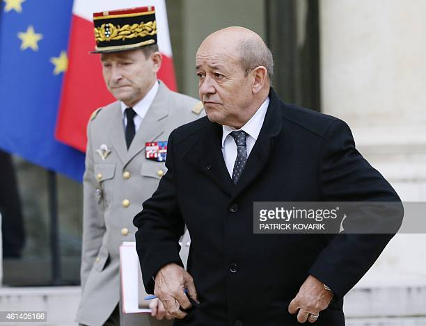 French Defence Minister JeanYves Le Drian flanked by French Army Chief of Staff General Pierre de Villiers leaves the Elysee Palace after a security...