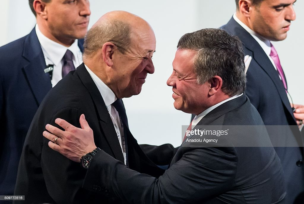 French Defence Minister Jean-Yves Le Drian (L) greets Jordan's King Abdullah (R) during the 52nd Security Conference in Munich, Germany on February 12, 2016. The conference on security policy takes place from Feb. 12, 2016 until Feb. 14, 2016.