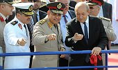 French Defence Minister JeanYves Le Drian his Egyptian counterpart Sedki Sobhi and Egyptian Navy Chief of staff Admiral Ossama Rabie gesture after...