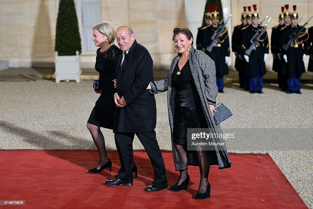 French Defence Minister <a gi-track='captionPersonalityLinkClicked' href=/galleries/search?phrase=Jean-Yves+Le+Drian&family=editorial&specificpeople=2122785 ng-click='$event.stopPropagation()'>Jean-Yves Le Drian</a> (C), his wife Maria Vadillo (R) and Dutch Defence Minister <a gi-track='captionPersonalityLinkClicked' href=/galleries/search?phrase=Jeanine+Hennis-Plasschaert&family=editorial&specificpeople=4314790 ng-click='$event.stopPropagation()'>Jeanine Hennis-Plasschaert</a> (L) arrive to the state dinner given by French President Francois Hollande in honor of Queen Maxima of the Netherlands and King Willem-Alexander of the Netherlands at Elysee Palace on March 10, 2016 in Paris, France. Queen Maxima and King Willem-Alexander of The Netherlands are on a two-day state visit in France
