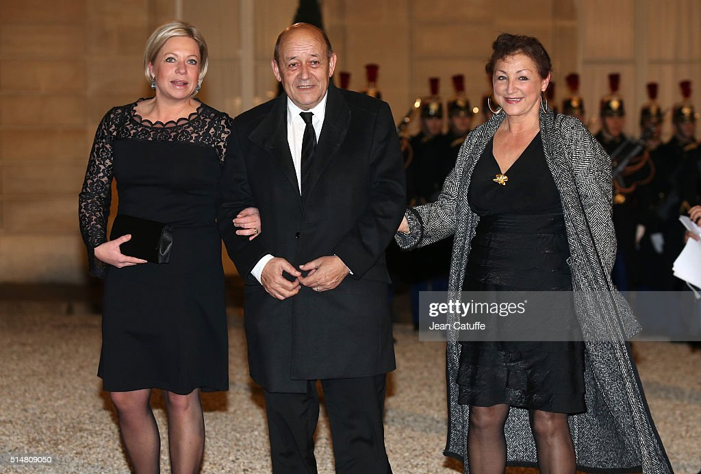 French Defence Minister <a gi-track='captionPersonalityLinkClicked' href=/galleries/search?phrase=Jean-Yves+Le+Drian&family=editorial&specificpeople=2122785 ng-click='$event.stopPropagation()'>Jean-Yves Le Drian</a>, his wife Maria Vadillo (R) and Dutch Defence Minister <a gi-track='captionPersonalityLinkClicked' href=/galleries/search?phrase=Jeanine+Hennis-Plasschaert&family=editorial&specificpeople=4314790 ng-click='$event.stopPropagation()'>Jeanine Hennis-Plasschaert</a> arrive at The State Dinner in Honor Of King Willem-Alexander of the Netherlands and Queen Maxima at Elysee Palace on March 10, 2016 in Paris, France. Queen Maxima and King Willem-Alexander of The Netherlands are on a two-day state visit in France.