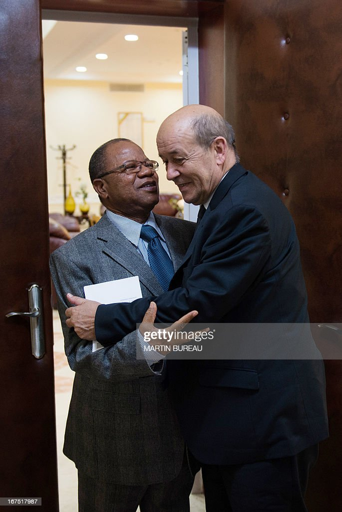 French Defence Minister Jean-Yves Le Drian (R) is welcome by Mali's Prime Minister Django Cissoko on April 25, 2013 in Bamako. Le Drian arrived in the Malian capital on the first leg of a tour of several countries to prepare for a post-war Mali. Mali called on France's help in January to halt an Islamist advance on Bamako and French and African troops have since pushed the Al-Qaeda-linked militants into desert and mountain hideouts, from where they are staging guerrilla attacks.