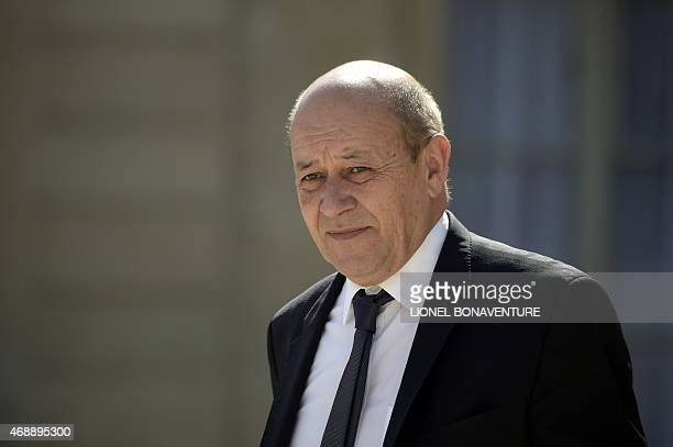 French Defence minister JeanYves Le Drian leaves following the weekly cabinet meeting at the Elysee palace on April 8 2015 in Paris AFP PHOTO /...