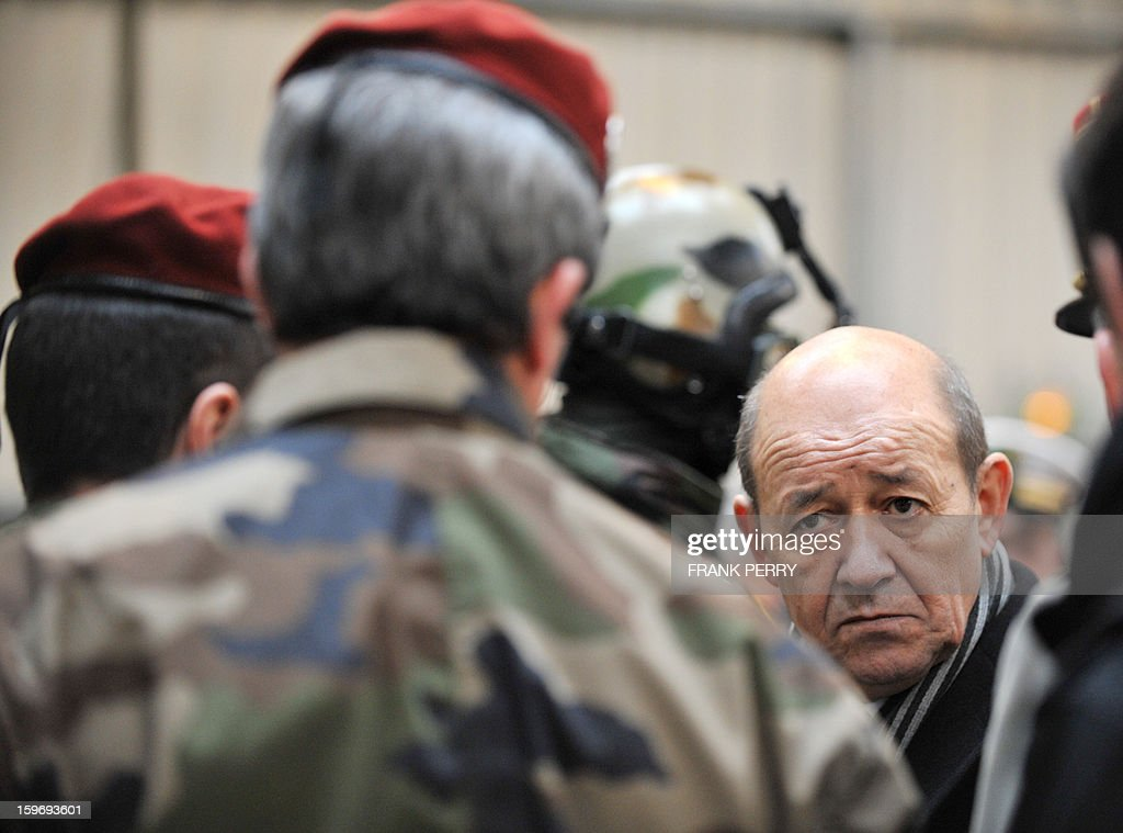 French Defence Minister Jean-Yves Le Drian (R) listens to explanations from a member of the French special forces during his visit to a sniper commando base on January 18, 2013 in the northwestern French town of Lanester.
