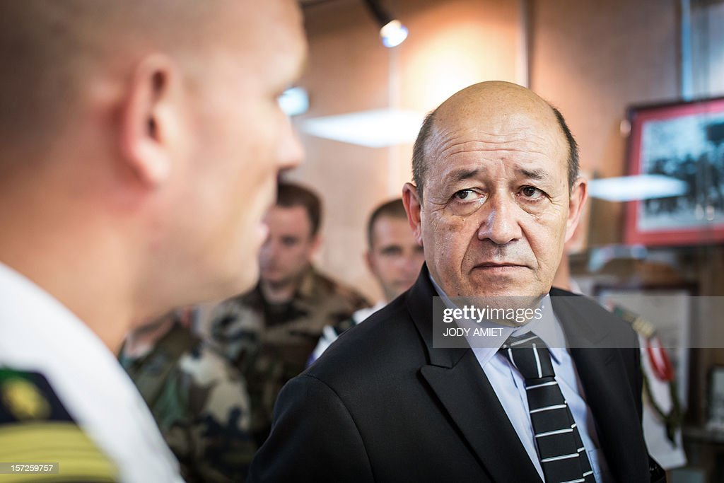 French Defence Minister Jean-Yves Le Drian (R) meets legionnaires in charge of protecting the Titan mission at the Guiana Space Center in Kourou, French Guiana, on November 30, 2012, as part of a three-day visit.