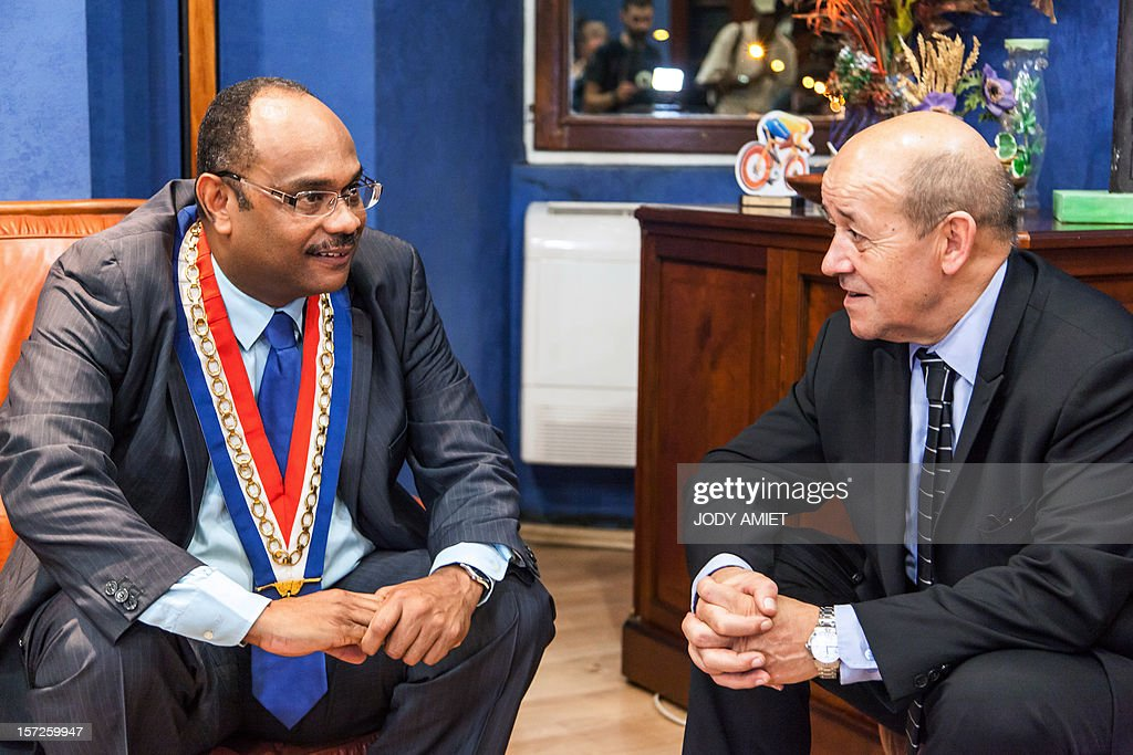 French Defence Minister Jean-Yves Le Drian (R) meets the mayor of Kourou Jean-Etienne Antoinette in Kourou, French Guiana, on November 30, 2012, as part of a three-day visit.