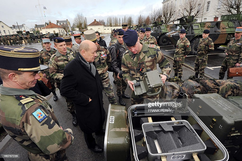 French defence minister Jean-Yves Le Drian (C) meets with reserve 'Guepard' soldiers from the third RIMA (Marine Infantry Regiment) on February 5, 2013 in Vannes. After a three-week campaign by French-led forces drove Islamist extremists from most of their strongholds in northern Mali, including the cities of Timbuktu and Gao, dozens of French warplanes carried out major air strikes on rebel training and logistics centres on February 3 in Mali's mountainous northeast, near the Algerian border. France is eager to pass the baton in Mali to some 8,000 African troops pledged for the UN-backed AFISMA force, still deploying at a snail's pace, after sweeping to its former colony's aid on January 11 as the Islamists threatened to advance south towards the capital Bamako.