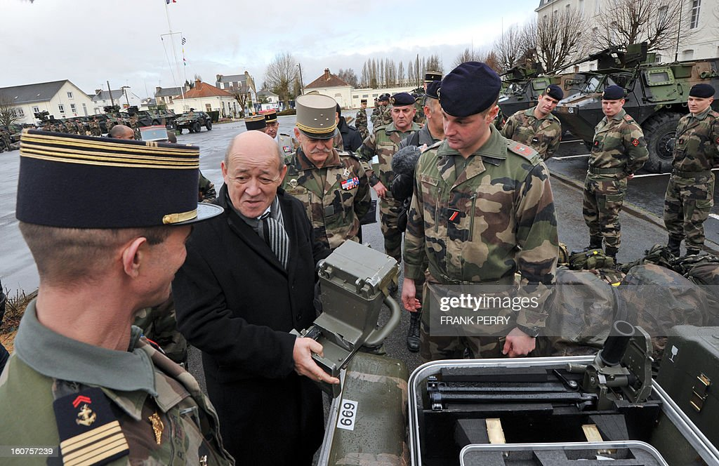 French defence minister Jean-Yves Le Drian (2nd L) meets with reserve 'Guepard' soldiers from the third RIMA (Marine Infantry Regiment) on February 5, 2013 in Vannes. After a three-week campaign by French-led forces drove Islamist extremists from most of their strongholds in northern Mali, including the cities of Timbuktu and Gao, dozens of French warplanes carried out major air strikes on rebel training and logistics centres on February 3 in Mali's mountainous northeast, near the Algerian border. France is eager to pass the baton in Mali to some 8,000 African troops pledged for the UN-backed AFISMA force, still deploying at a snail's pace, after sweeping to its former colony's aid on January 11 as the Islamists threatened to advance south towards the capital Bamako.