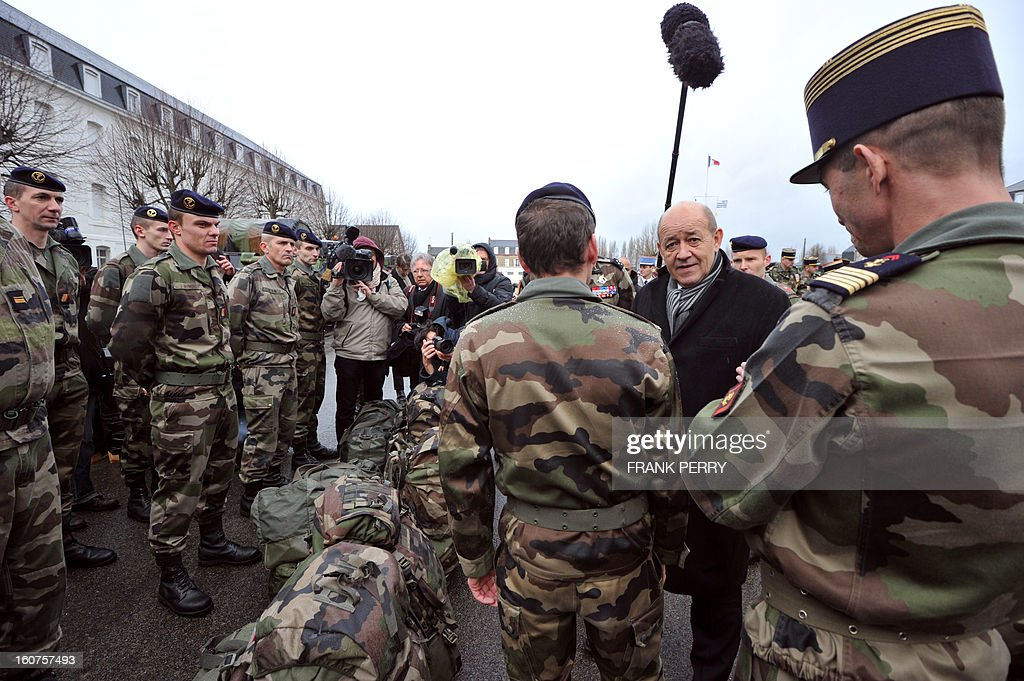 French defence minister Jean-Yves Le Drian (2nd R) meets with reserve 'Guepard' soldiers from the third RIMA (Marine Infantry Regiment), accompanied by commanders of the regiment Colonel Steiger (R) and General Clement-Bollee (L), on February 5, 2013 in Vannes. After a three-week campaign by French-led forces drove Islamist extremists from most of their strongholds in northern Mali, including the cities of Timbuktu and Gao, dozens of French warplanes carried out major air strikes on rebel training and logistics centres on February 3 in Mali's mountainous northeast, near the Algerian border. France is eager to pass the baton in Mali to some 8,000 African troops pledged for the UN-backed AFISMA force, still deploying at a snail's pace, after sweeping to its former colony's aid on January 11 as the Islamists threatened to advance south towards the capital Bamako.