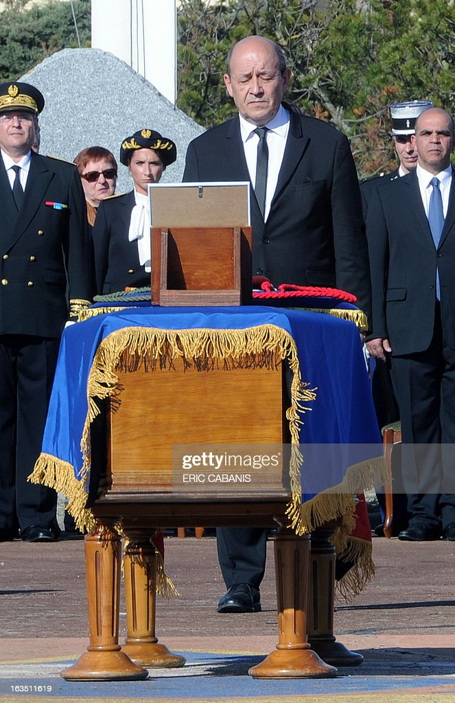 French Defence Minister Jean-Yves Le Drian observes a minute of silence on March 11, 2013 in Pamiers, during the funeral ceremony for French Caporal Cedric Charenton killed in fighting in northern Mali. Cedric Charenton, 26, from the First Parachute Chasseur Regiment, who had been deployed in Mali since January 25, had previously served in Afghanistan and Gabon.