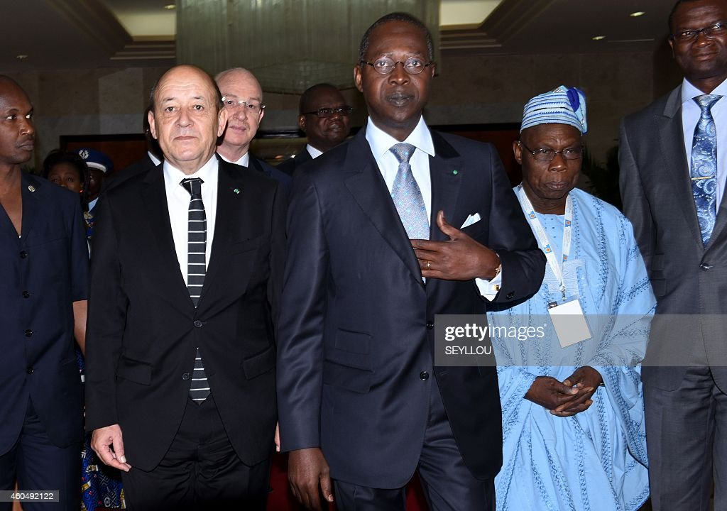 French Defence Minister Jean-Yves Le Drian, Senegalese Prime Minister Mohammed Dionne and former Nigerian president Olusegun Obasanjo attend the opening of the first international forum on peace and security in Africa, in Dakar on December 15, 2014.