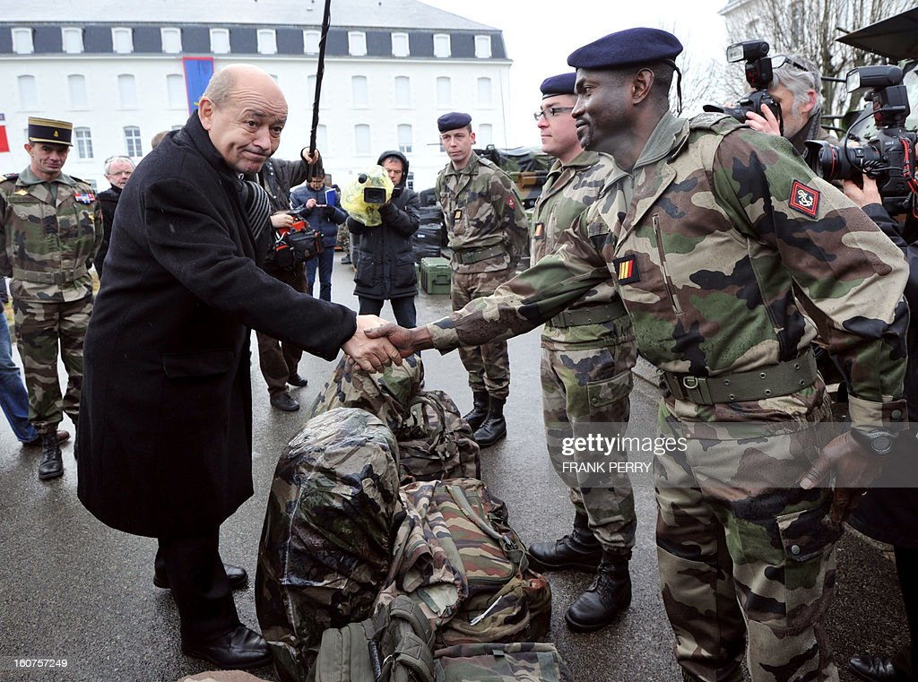 French defence minister Jean-Yves Le Drian (2nd L) shakes hands with a reserve 'Guepard' soldier from the third RIMA (Marine Infantry Regiment), amidst his comrades, on February 5, 2013 in Vannes. After a three-week campaign by French-led forces drove Islamist extremists from most of their strongholds in northern Mali, including the cities of Timbuktu and Gao, dozens of French warplanes carried out major air strikes on rebel training and logistics centres on February 3 in Mali's mountainous northeast, near the Algerian border. France is eager to pass the baton in Mali to some 8,000 African troops pledged for the UN-backed AFISMA force, still deploying at a snail's pace, after sweeping to its former colony's aid on January 11 as the Islamists threatened to advance south towards the capital Bamako.
