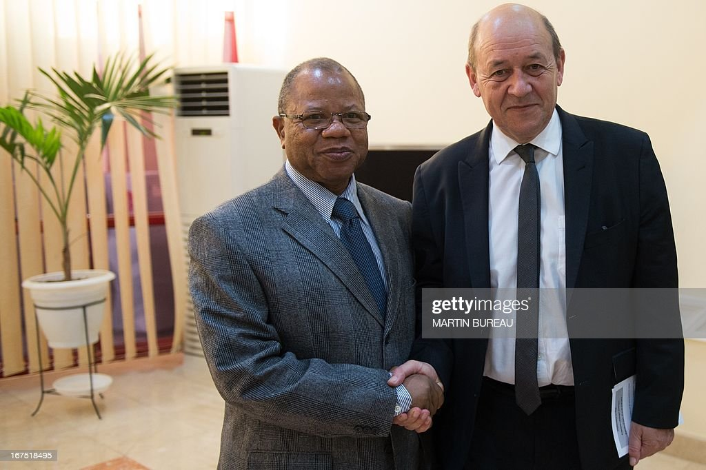 French Defence Minister Jean-Yves Le Drian (R) shakes hands with Mali's Prime Minister Django Cissoko, on April 25, 2013 in Bamako. Le Drian arrived in the Malian capital on the first leg of a tour of several countries to prepare for a post-war Mali. Mali called on France's help in January to halt an Islamist advance on Bamako and French and African troops have since pushed the Al-Qaeda-linked militants into desert and mountain hideouts, from where they are staging guerrilla attacks.