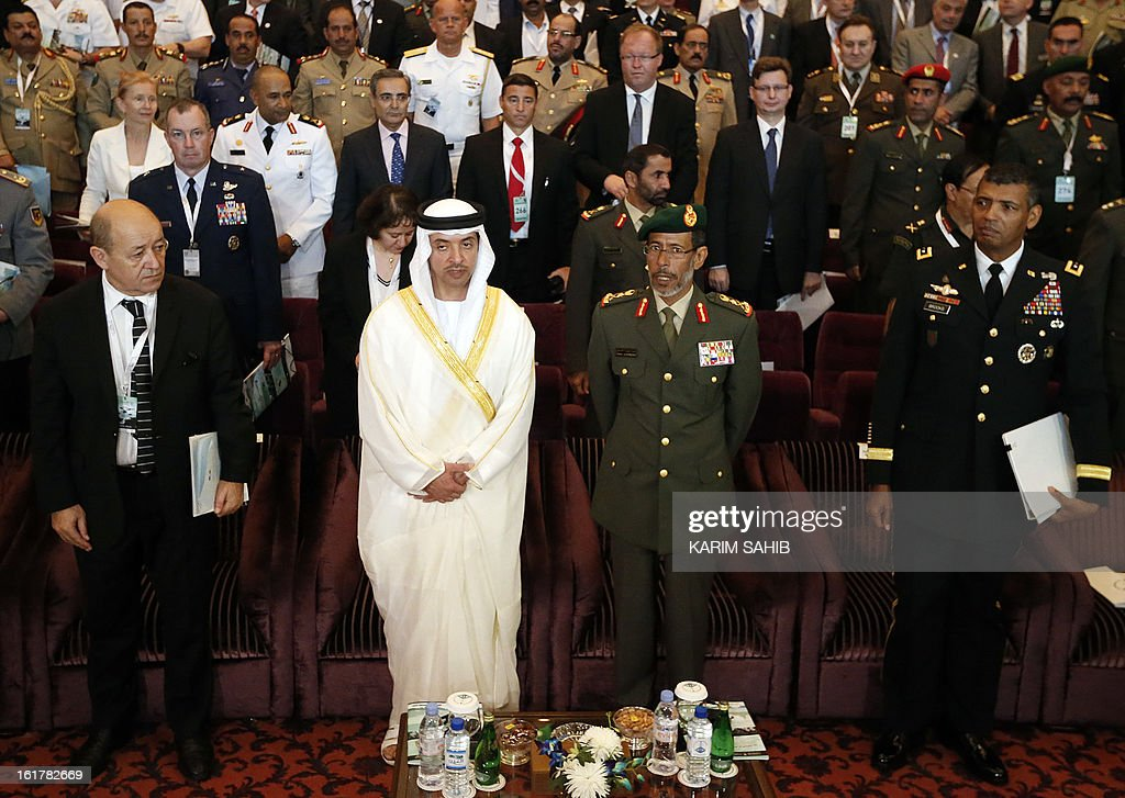 French Defence Minister Jean-Yves Le Drian, Sheikh Hazza bin Zayed Al Nahyan, the UAE national security advisor, Chief of Staff of the UAE Armed Forces Lieutenant General Hamad Mohammed Thani Al-Rumaithi and American Lieutenant General Vincent Brooks, attend the opening of the INEGMA (Institute for Near East and Gulf Military Analysis) defence conference on February 16, 2013, in Abu Dhabi.