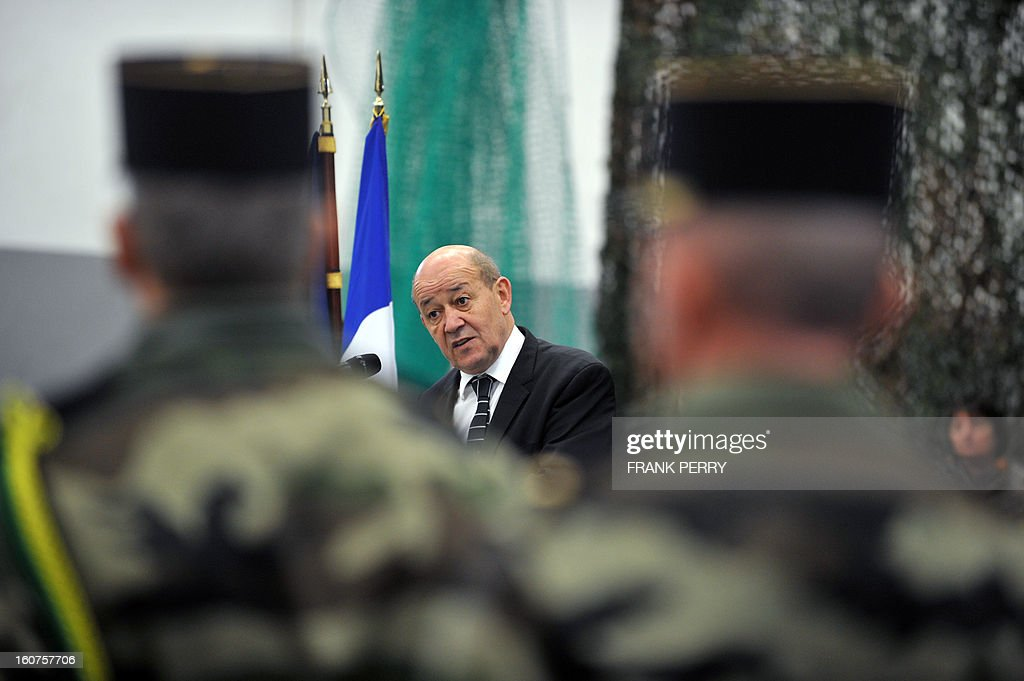 French defence minister Jean-Yves Le Drian speaks during a visit to 'Guepard' soldiers from the third RIMA (Marine Infantry Regiment) on February 5, 2013 in Vannes. After a three-week campaign by French-led forces drove Islamist extremists from most of their strongholds in northern Mali, including the cities of Timbuktu and Gao, dozens of French warplanes carried out major air strikes on rebel training and logistics centres on February 3 in Mali's mountainous northeast, near the Algerian border. France is eager to pass the baton in Mali to some 8,000 African troops pledged for the UN-backed AFISMA force, still deploying at a snail's pace, after sweeping to its former colony's aid on January 11 as the Islamists threatened to advance south towards the capital Bamako.