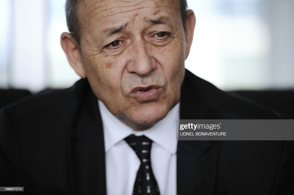 French Defence Minister, Jean-Yves Le Drian speaks to French soldiers Paphos airport in Cyprus in December 8, 2012 before leaving for France. Le Drian today welcomed some 150 French soldiers returning from Afghanistan.