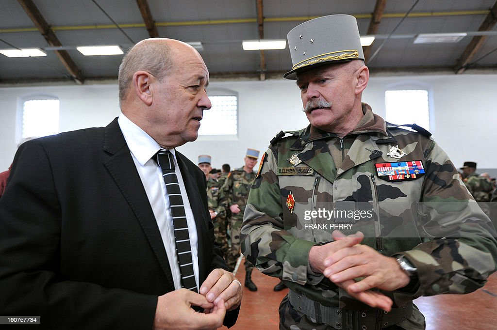 French defence minister Jean-Yves Le Drian speaks with French ground troops commander General Bruno Clement-Bollee during a visit to 'Guepard' soldiers from the third RIMA (Marine Infantry Regiment) on February 5, 2013 in Vannes. After a three-week campaign by French-led forces drove Islamist extremists from most of their strongholds in northern Mali, including the cities of Timbuktu and Gao, dozens of French warplanes carried out major air strikes on rebel training and logistics centres on February 3 in Mali's mountainous northeast, near the Algerian border. France is eager to pass the baton in Mali to some 8,000 African troops pledged for the UN-backed AFISMA force, still deploying at a snail's pace, after sweeping to its former colony's aid on January 11 as the Islamists threatened to advance south towards the capital Bamako.