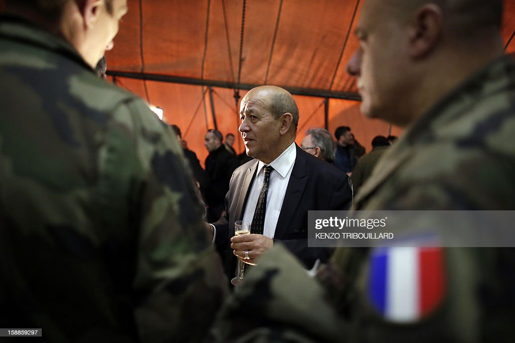 French Defence Minister Jean-Yves Le Drian (C) speaks with French soldiers during his New Year wishes to French soldiers at Kabul International Airport (KAIA) on January 01, 2013.
