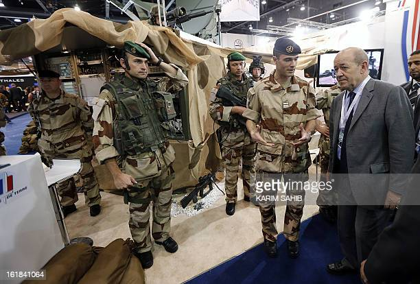 French Defence Minister JeanYves Le Drian speaks with French troops during the opening of the International Defence Exhibition and Conference at the...