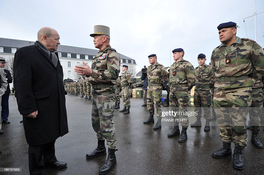 French defence minister Jean-Yves Le Drian (L) speaks with General Clement-Bollee as he meets with reserve 'Guepard' soldiers from the third RIMA (Marine Infantry Regiment), on February 5, 2013 in Vannes. After a three-week campaign by French-led forces drove Islamist extremists from most of their strongholds in northern Mali, including the cities of Timbuktu and Gao, dozens of French warplanes carried out major air strikes on rebel training and logistics centres on February 3 in Mali's mountainous northeast, near the Algerian border. France is eager to pass the baton in Mali to some 8,000 African troops pledged for the UN-backed AFISMA force, still deploying at a snail's pace, after sweeping to its former colony's aid on January 11 as the Islamists threatened to advance south towards the capital Bamako.