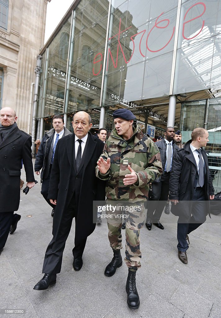 French Defence minister Jean-Yves Le Drian speaks with security forces deployed on December 21, 2012 at Gare du Nord railway station in Paris as France's national security alert system 'Plan Vigipirate' is reinforced for the Christmas holidays .