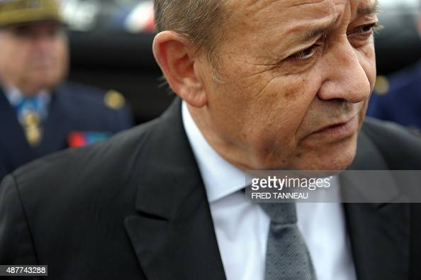 French defence minister JeanYves Le Drian talks to journalists during the inauguration ceremony of the 7th Marine Commando 'Ponchardier' on September...