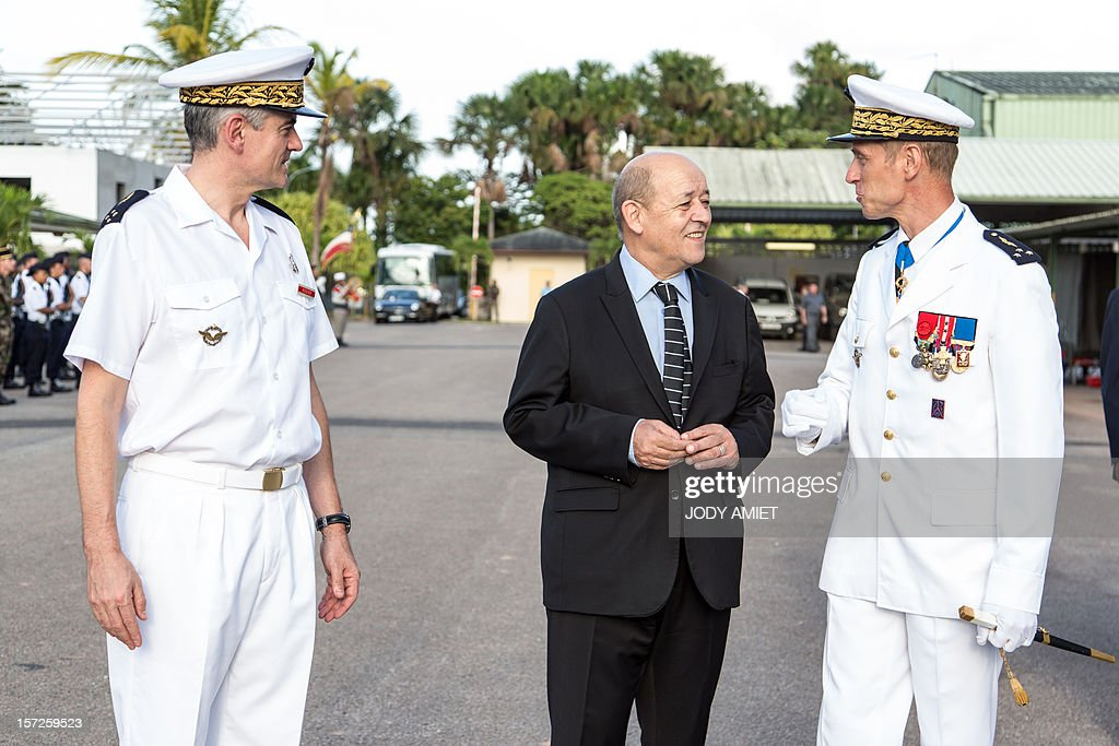 French Defence Minister Jean-Yves Le Drian (C) visits the air-base 367 in Cayenne, French overseas region of Guiana, on November 30, 2012, as part of a three-day visit.