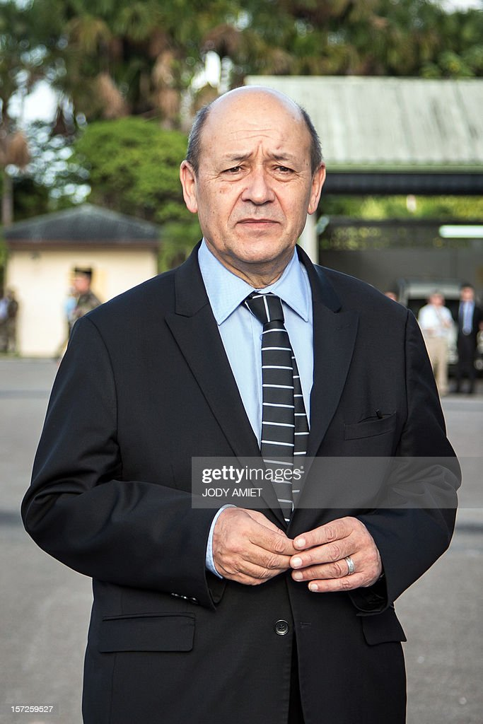 French Defence Minister Jean-Yves Le Drian visits the air-base 367 in Cayenne, French overseas region of Guiana, on November 30, 2012, as part of a three-day visit. AFP PHOTO JODY AMIET