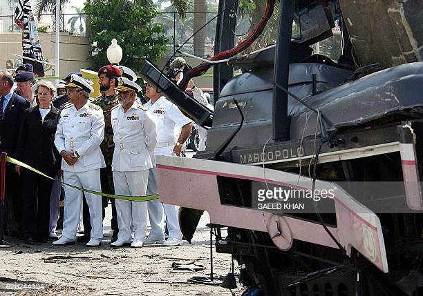 French Defence Minister Michele AlliotMarie inspects the site of a suicide bomb attack along with Pakistan's Naval Chief Admiral Aziz Mirza in the...