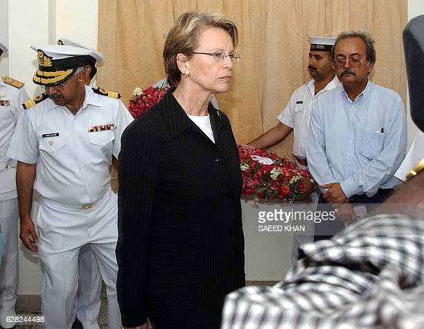 French Defence Minister Michele AlliotMarie leaves the room after laying wreath on the bodies of her countrymates who were killed in a suicide bomb...