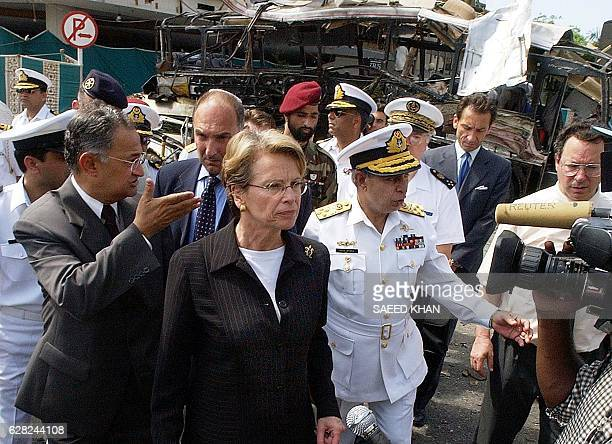 French Defence Minister Michele AlliotMarie leaves the site of the suicide bomb attack after seeing the devastated bus in which 11 French national...