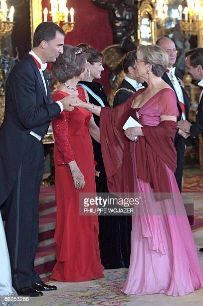 French Defence Minister Michele AlliotMarie shakes hand with Spain's Crown Prince Felipe during a presentation ceremony prior to a dinner at the...